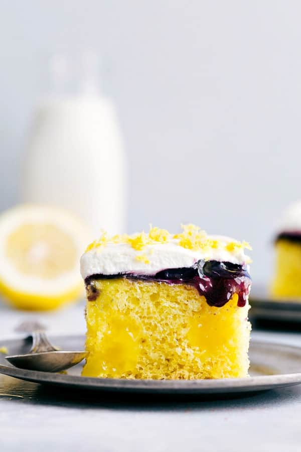 Lemon Blueberry Poke Cake on a plate.