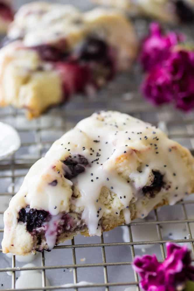 Summer Berry Scones with a sweet, tart, lemon glaze and a sprinkling of poppy seeds via The Recipe Critic