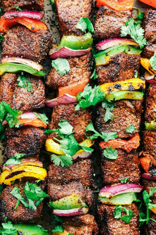 Grilled Steak Fajita Skewers with Avocado Chimichurri close up.
