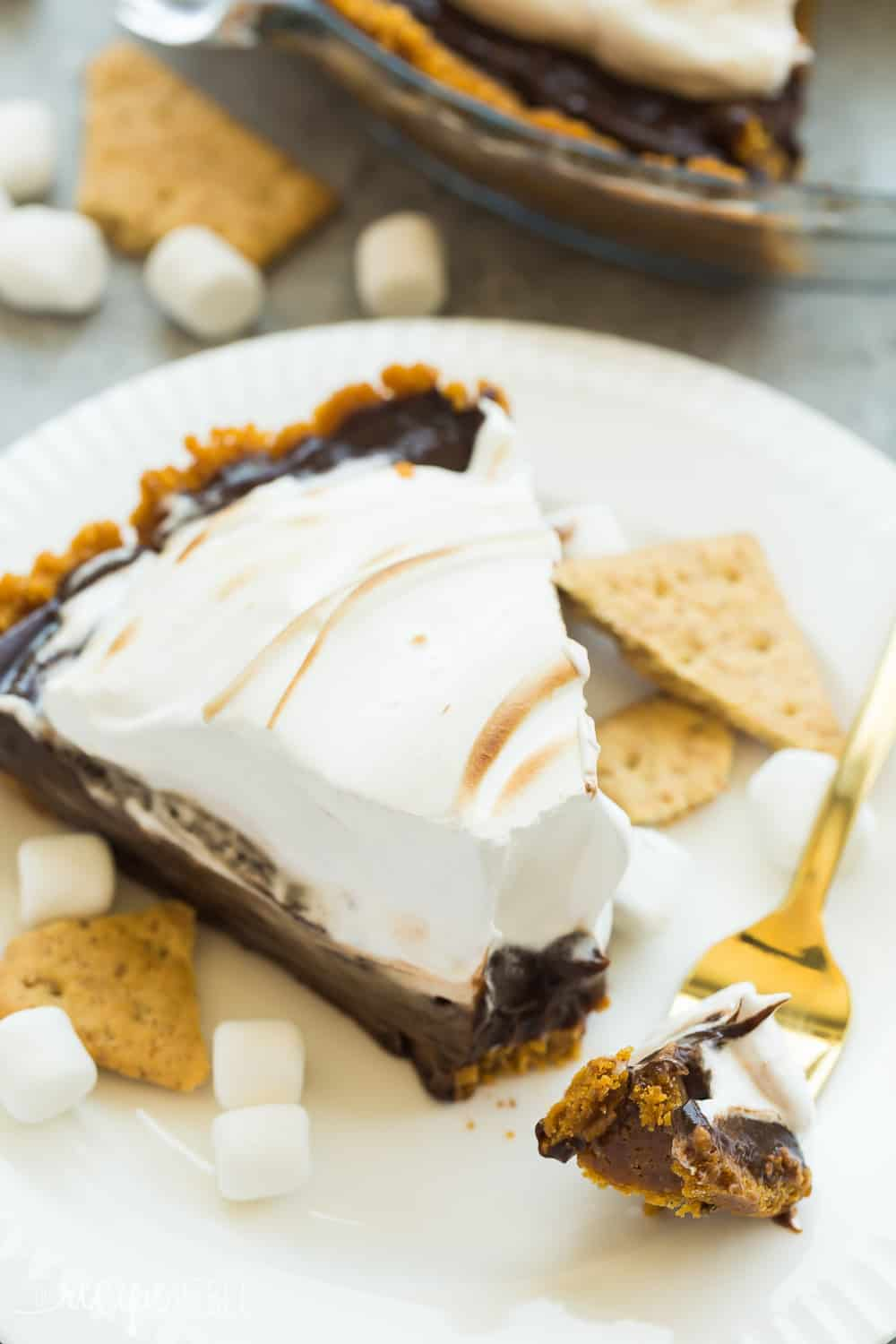 This No Bake S'mores Pie is the easiest summer dessert! A graham cracker crust is loaded with chocolate filling and topped with marshmallow cream!