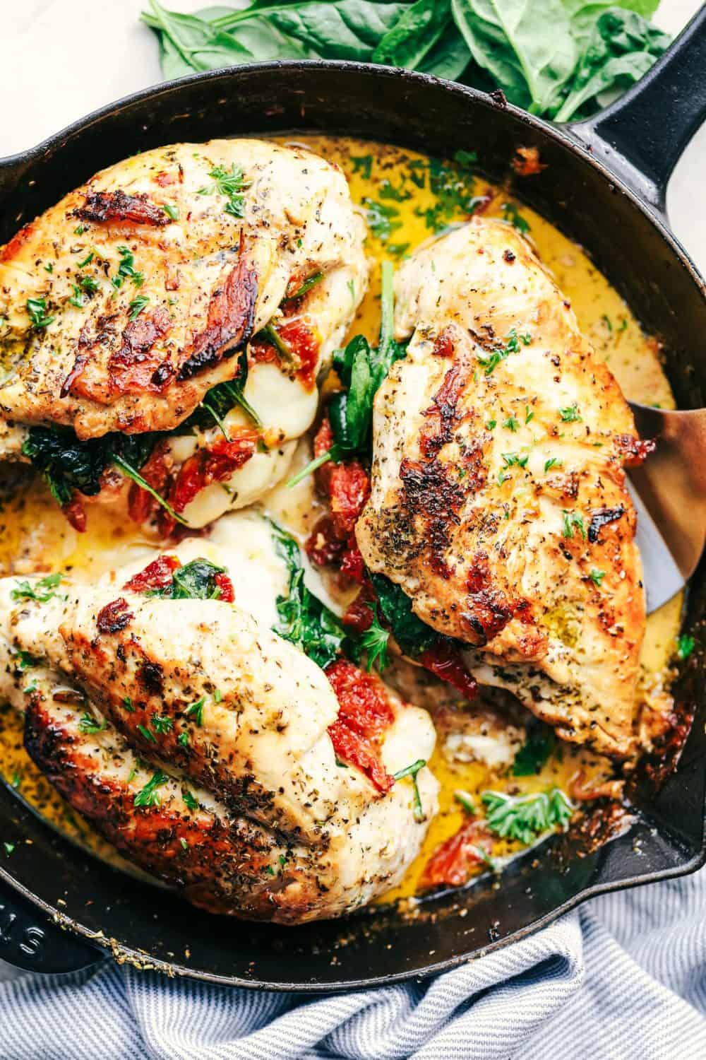 Stuffed Tuscan Garlic Chicken in a skillet.