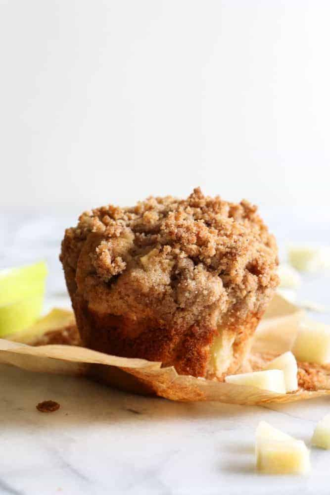 Apple Crumb Muffins.  Light and fluffy bakery style muffins loaded up with bits of fresh apple and spiced with a hint of cinnamon.  All topped off with a delicate brown sugar crumble.