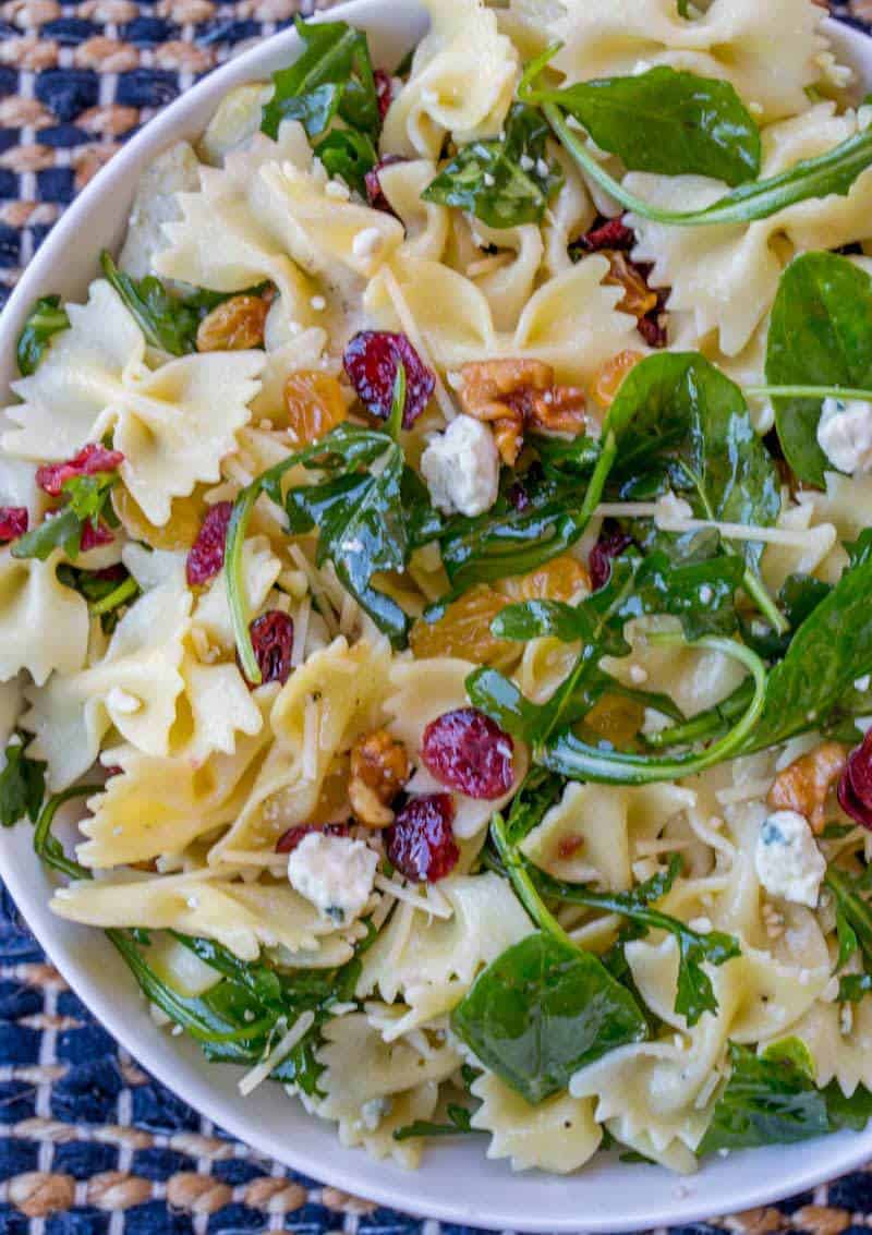 Cranberry Feta Bowtie Salad with Spinach is an easy salad perfect for potlucks and the holidays with an easy dijon vinaigrette dressing, raisins and walnuts.