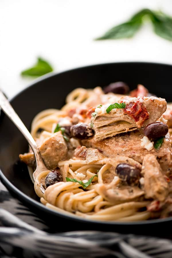 Creamy Mediterranean Chicken is a quick and easy comforting dish. It's full of tender chicken, artichokes, kalamata olives, and sun dried tomatoes all robed in a delicious creamy sauce.