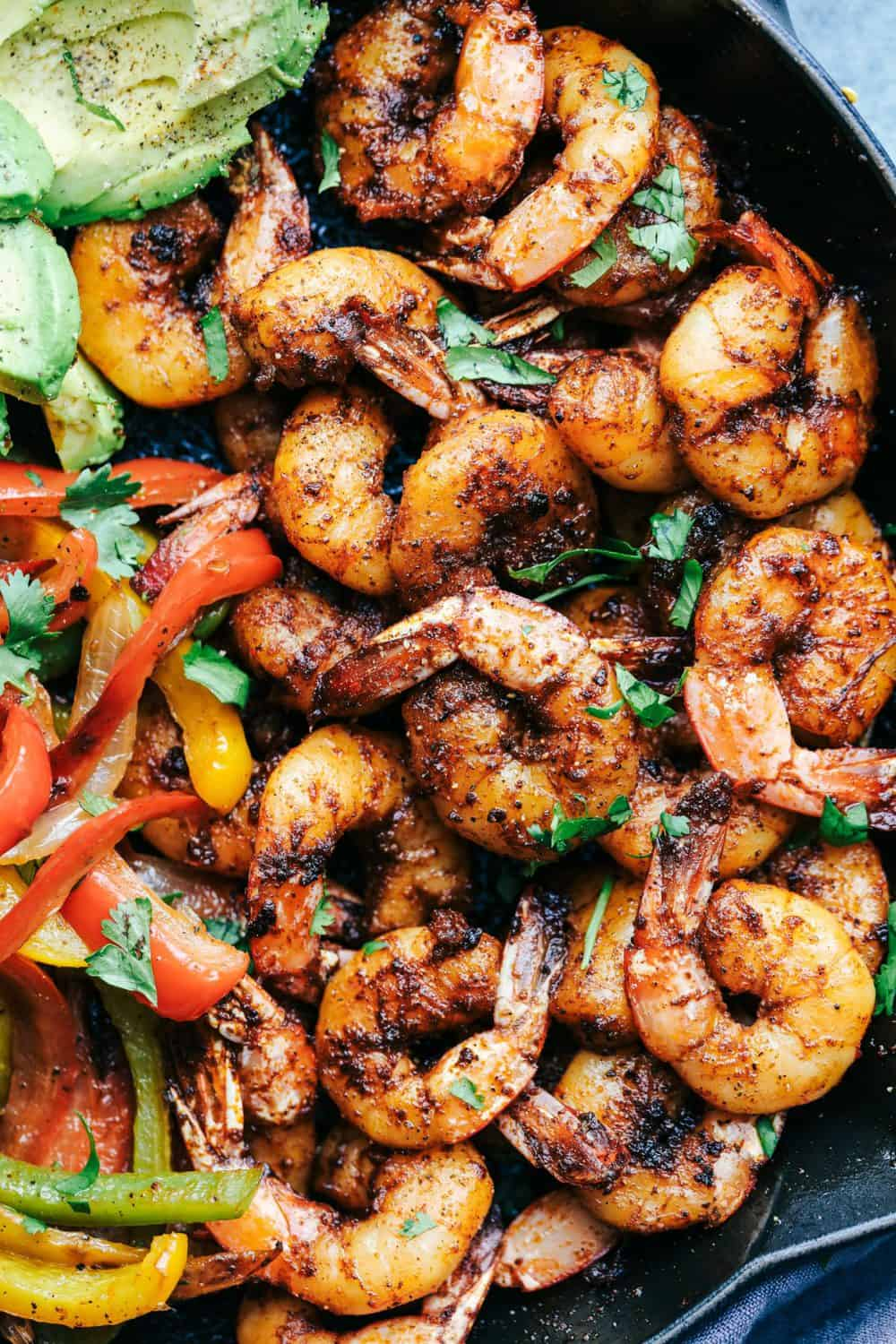 20 Minute Skillet Blackened Shrimp Fajitas in a skillet.