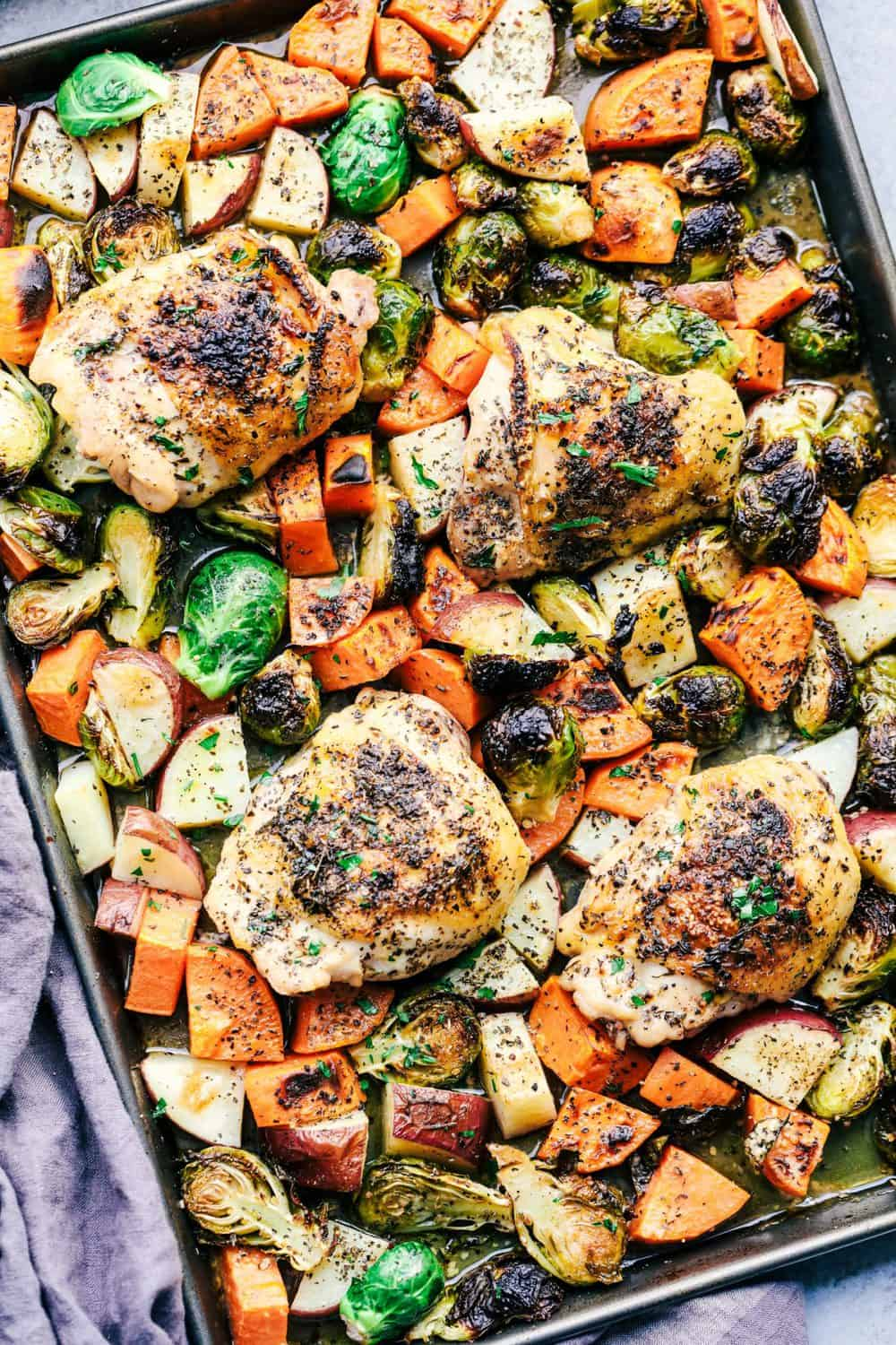 Sheet pan roasted garlic herb chicken with potatoes and for Chicken and brussel sprouts skillet
