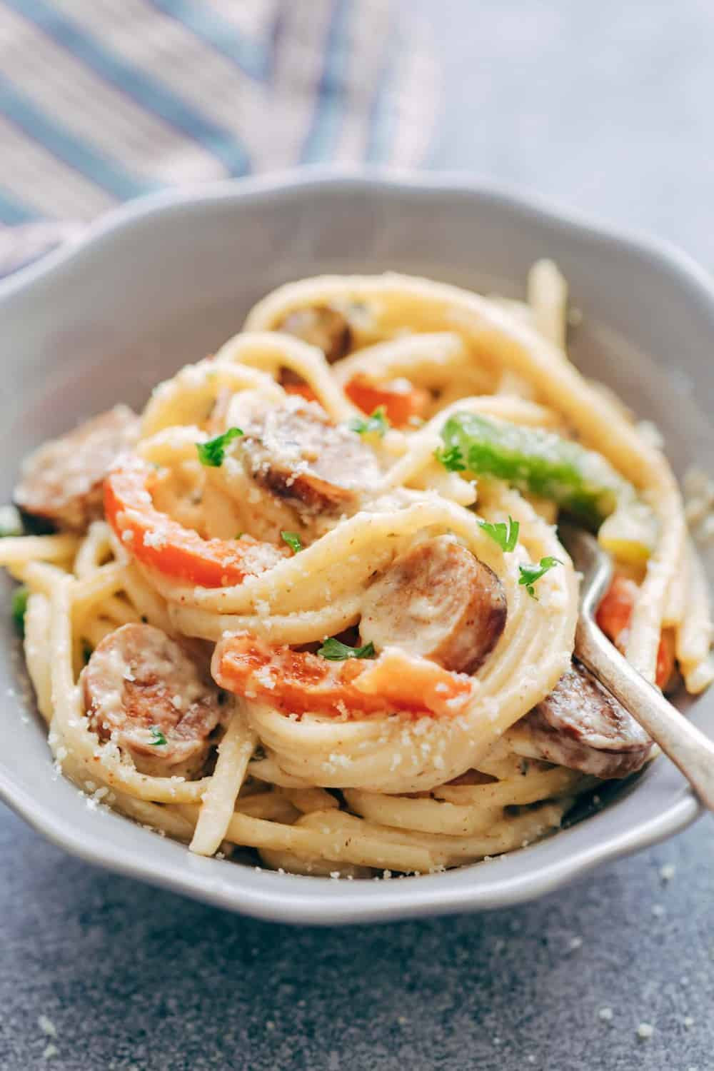 Creamy Cajun Sausage Linguine is a creamy 30 minute pasta recipe that's going to become a family favourite! Not too heavy on the cheese but still super creamy!