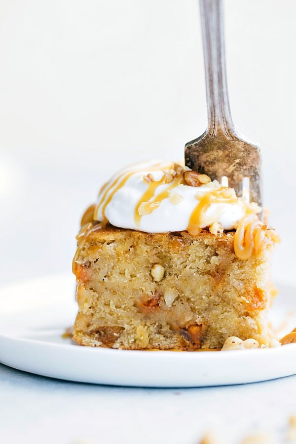 Sticky Banana Walnut Toffee Pudding Cake on a white plate.