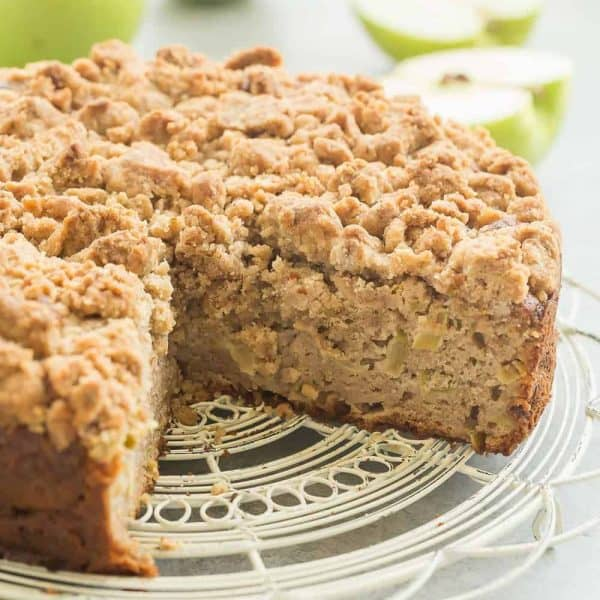 This Crumb-Topped Apple Coffee Cake is perfect for fall! Greek yogurt and extra apples keep it moist and a crunchy crumb topping gives it extra decadence!