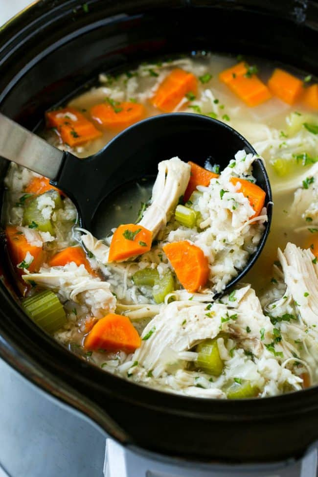 This slow cooker chicken and rice soup in a crock pot.