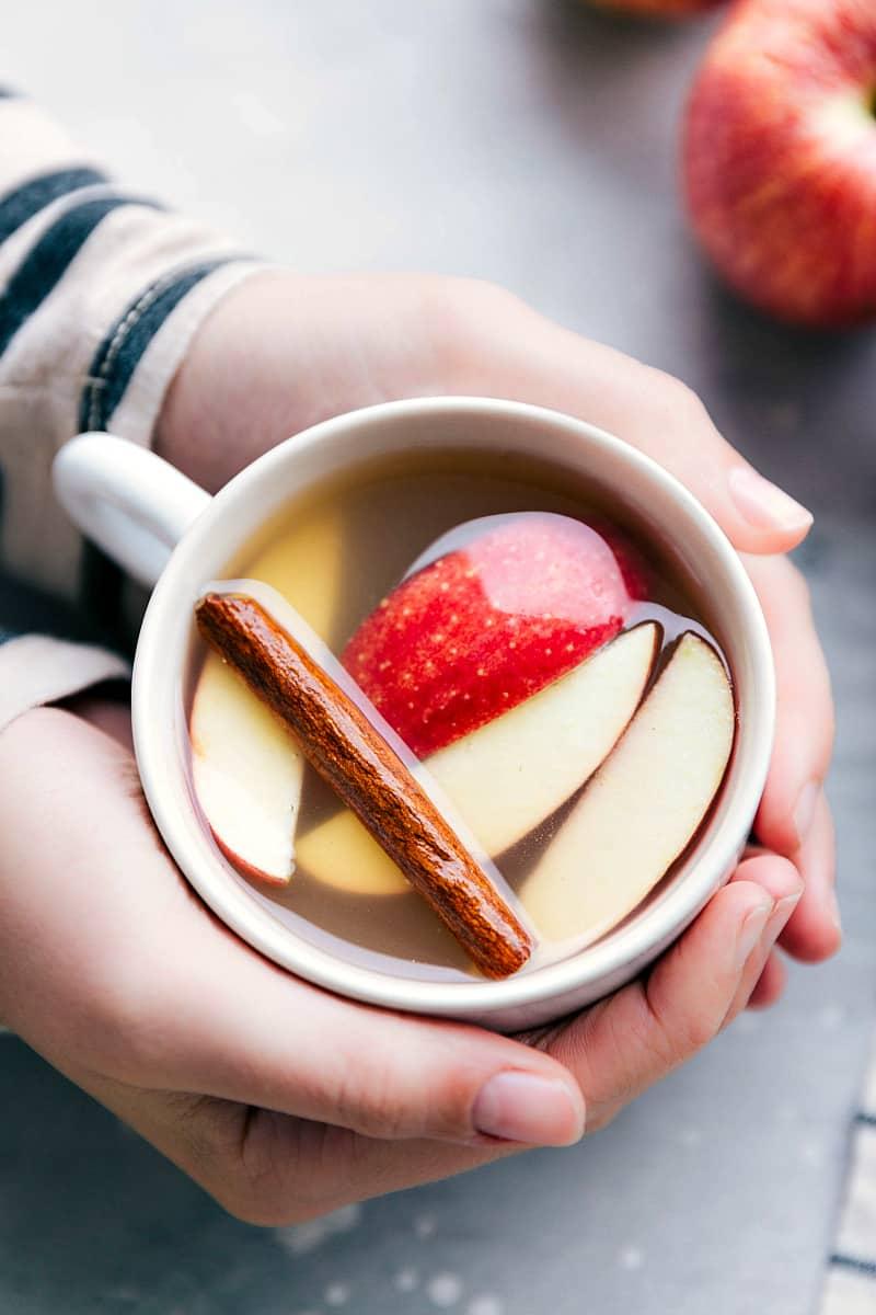 Homemade apple cider in a white mug.