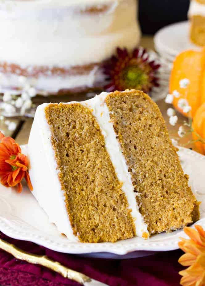 A slice of soft, moist, and EASY Pumpkin Cake, made from scratch and frosted with a simple, silky cream cheese frosting!