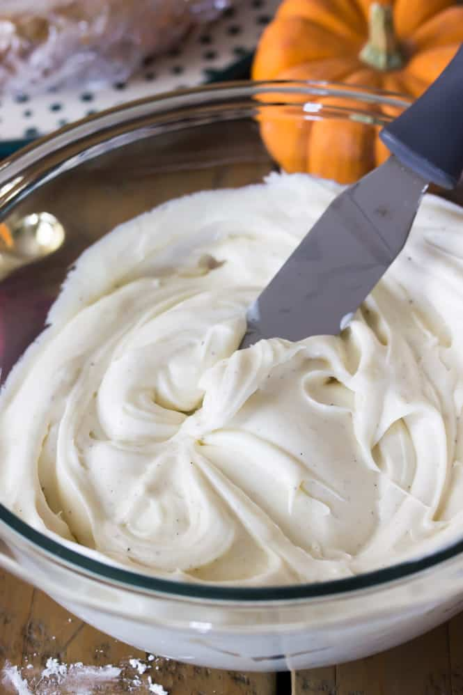 Vanilla bean frosting in a glass bowl.