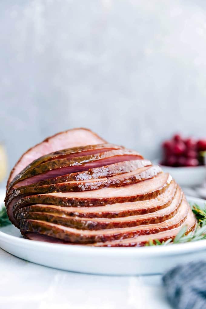 Sliced ham on a white plate.