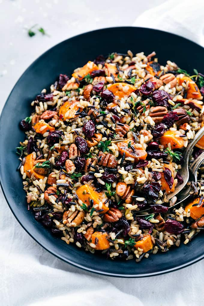 Cranberry Pecan Sweet Potato Wild Rice Pilaf on a black plate.