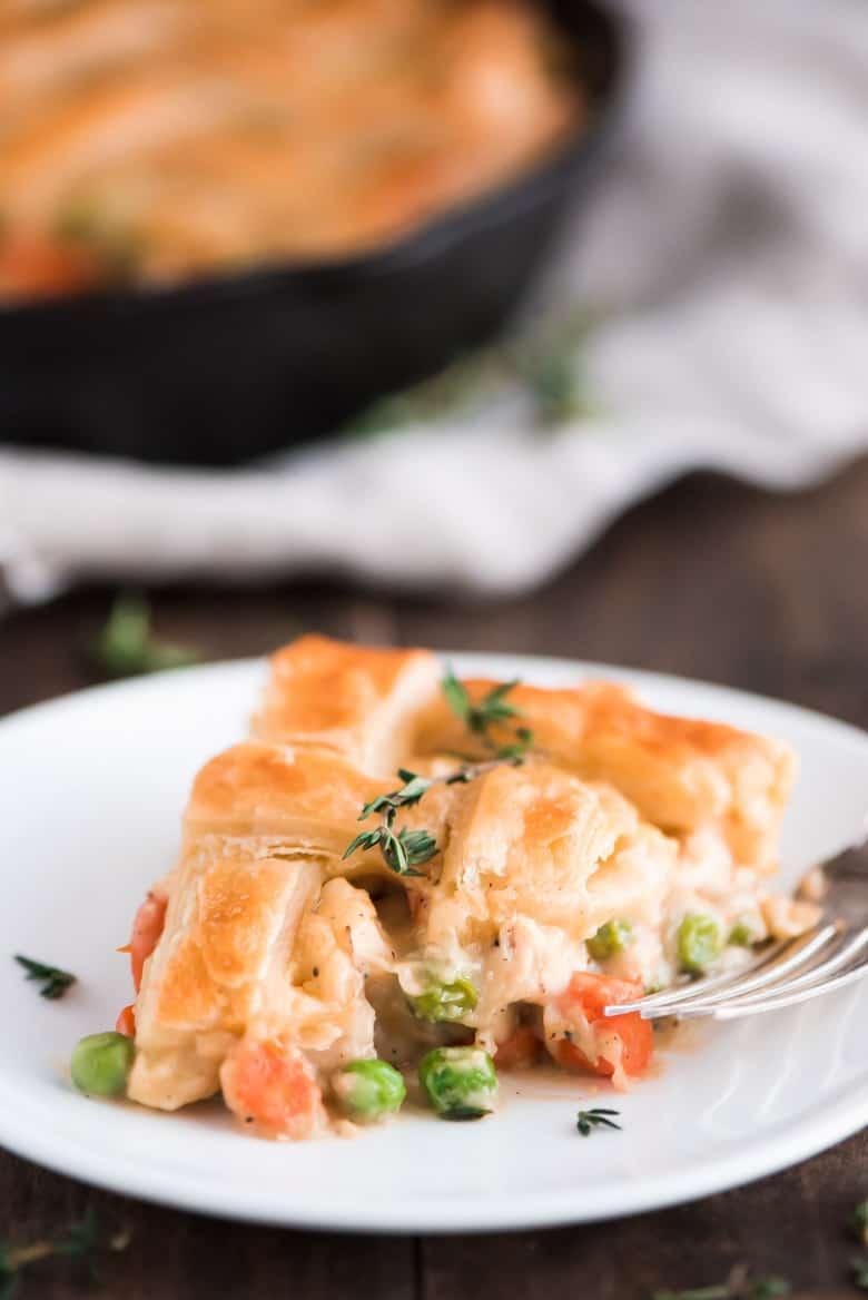 One Skillet Chicken Pot Pie slice on a white plate.