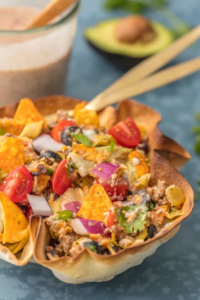Creamy Taco Salad with bean dip in the background.