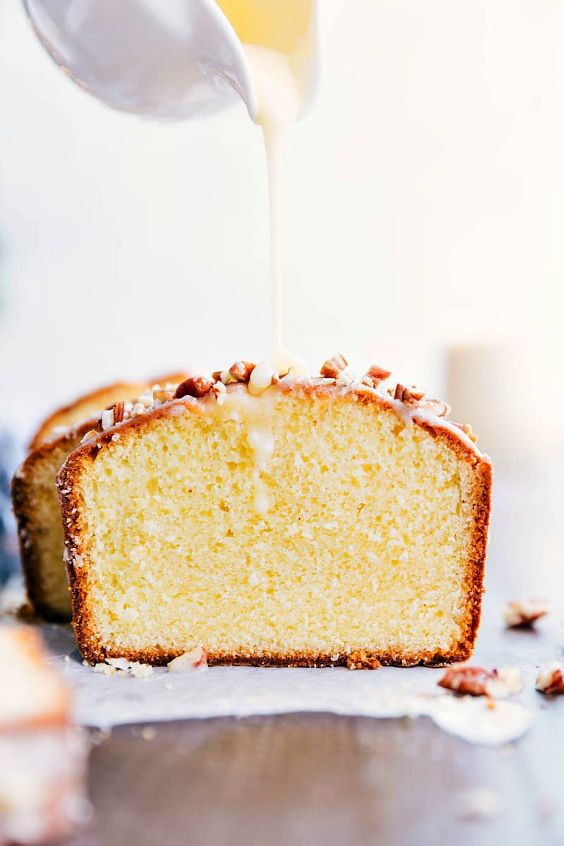 Glazed Eggnog Pound Cake getting drizzled with a luscious glaze.