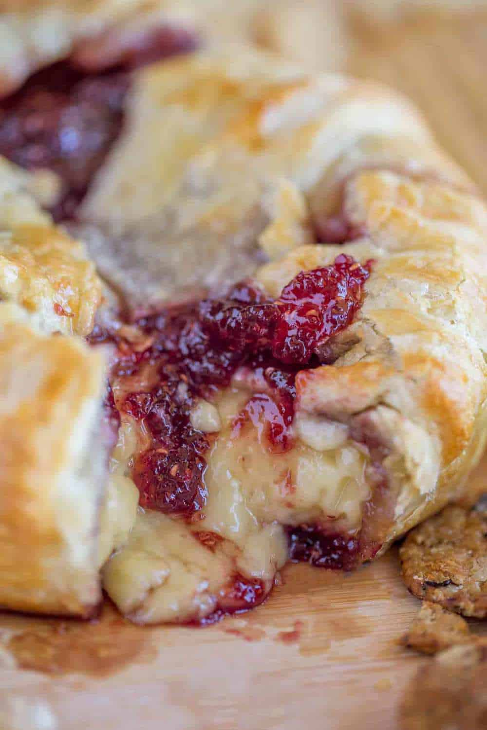 Creamy, delicious, baked brie with raspberry preserves.