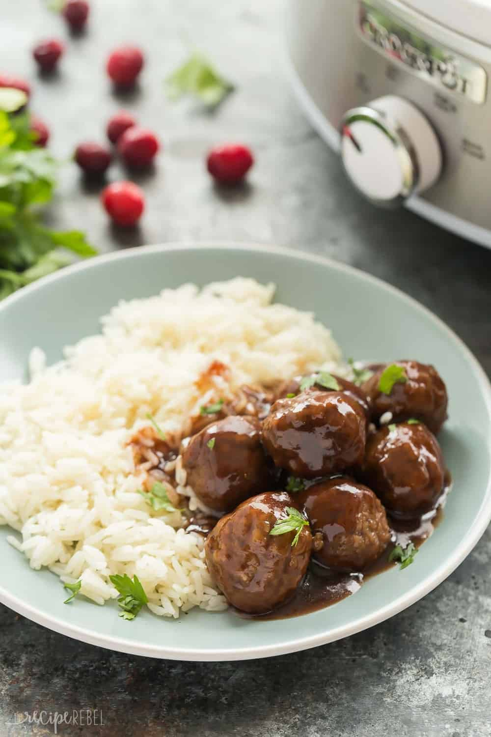 Slow Cooker Cranberry Balsamic Meatballs with white rice on a plate.