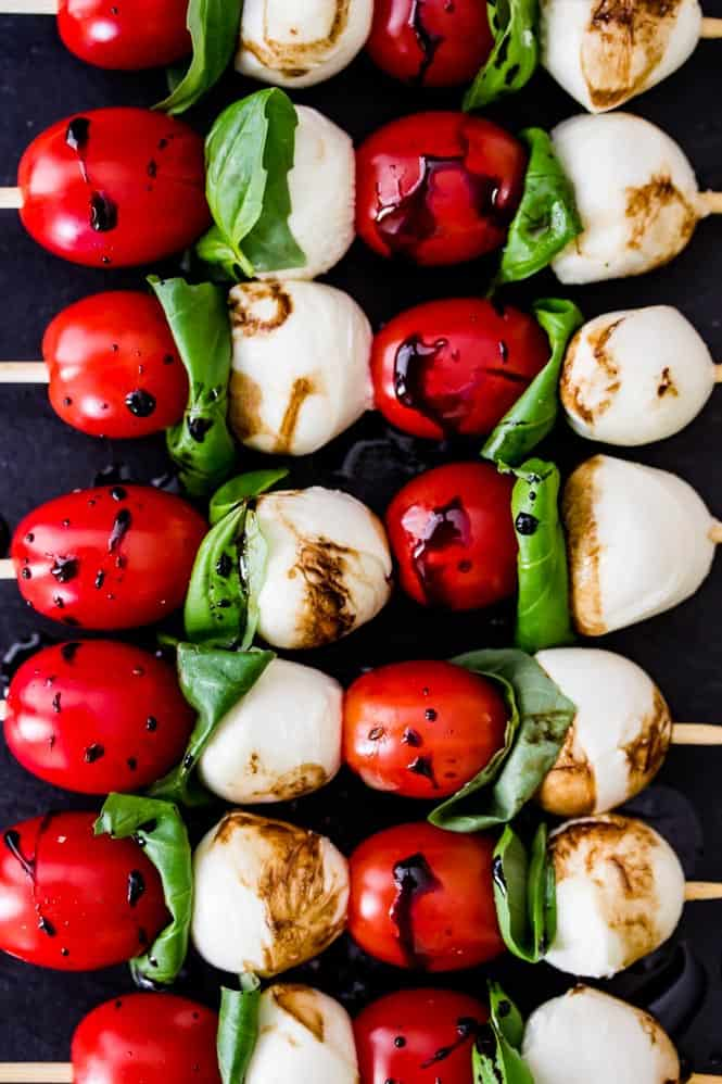 Caprese Skewers with balsamic vinegar drizzled on top.