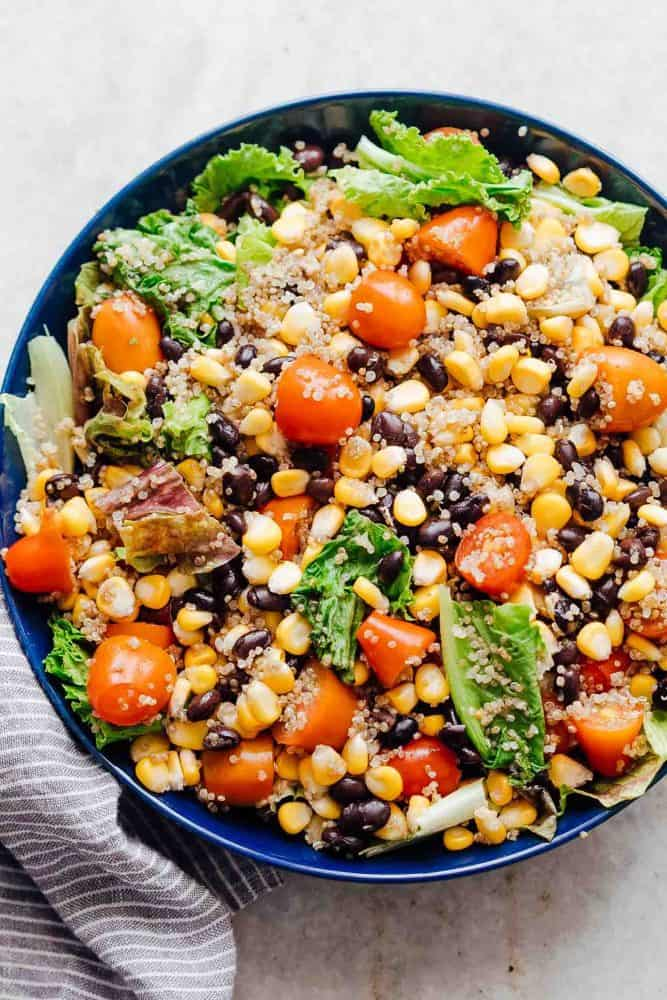 A big blue bowl of southwest quinoa bean salad.