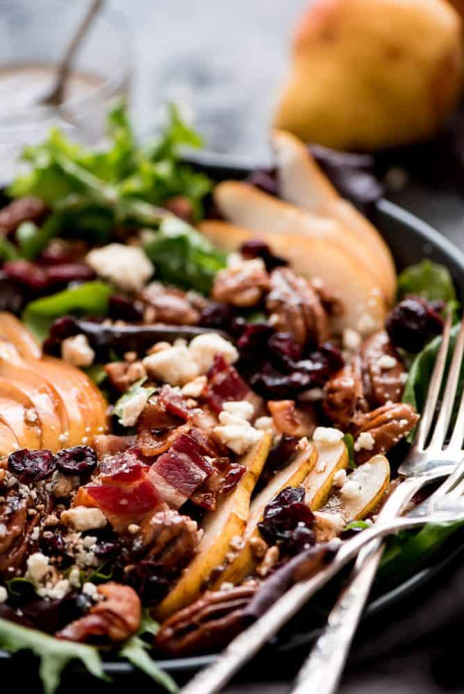Bacon Pear Gorgonzola Salad in a bowl with two forks.