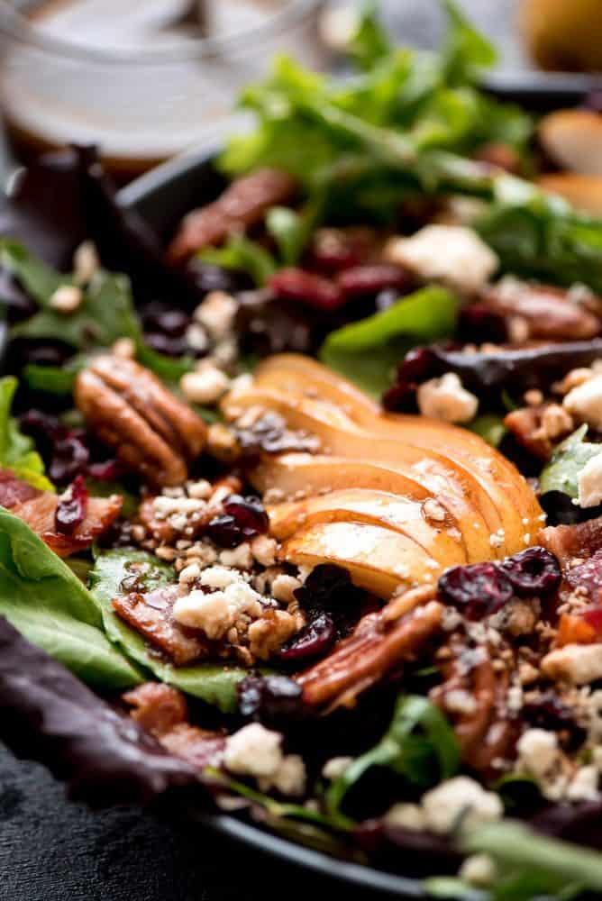 Bacon Pear Gorgonzola Salad in a black bowl.