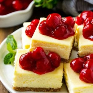 These cherry cheesecake bars are the perfect make-ahead dessert for any occasion! Creamy cheesecake sits atop a homemade graham cracker crust, and is finished off with a generous helping of cherries.