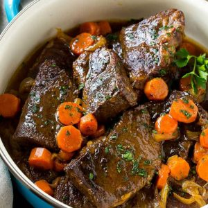 These fork tender root beer glazed short ribs are the perfect meal for a cold winter night. Serve them over mashed potatoes for a dinner that's sure to earn rave reviews from family and friends!