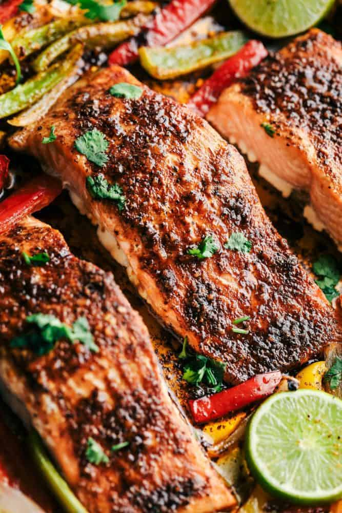 Sheet Pan Garlic Lime Salmon with lime and cut peppers.