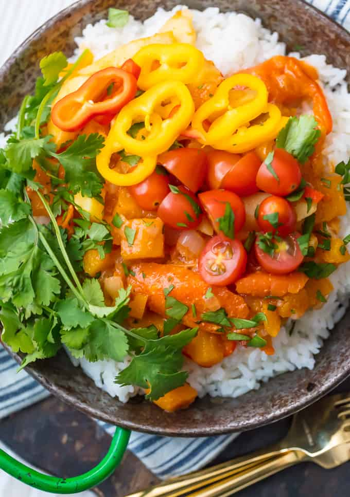 Vegetable Curry over white rice in a bowl with forks.