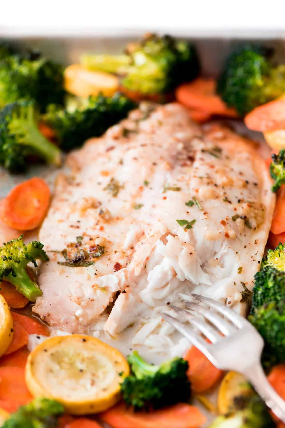 This Baked Tilapia and Roasted Veggies is a low calorie and high protein dish that comes together in less than 25 minutes!