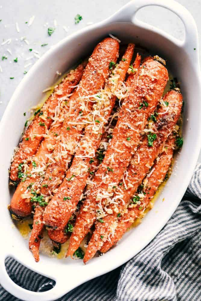 Garlic Butter Parmesan Carrots in a white dish.