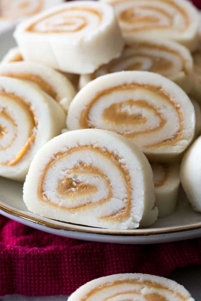Peanut Butter Pinwheel Candy stacked on top of each other on a plate.