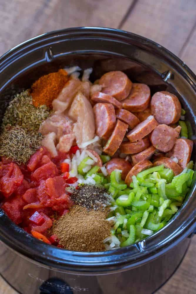 Jambalaya Ingredients loaded into a slow cooker.