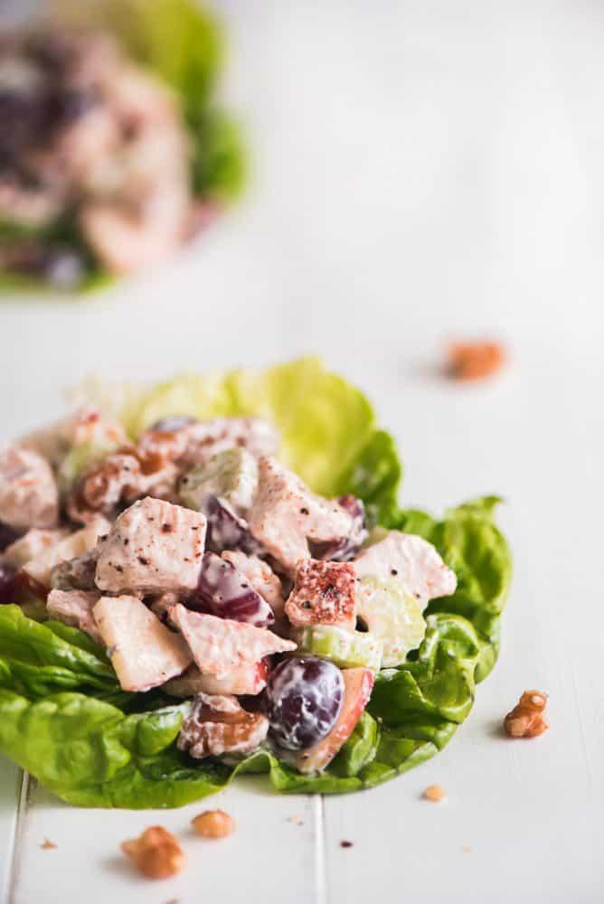 Waldorf Chicken Salad on a leaf of lettuce.