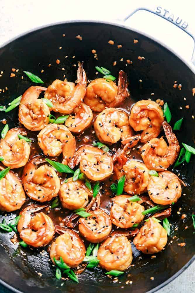 Sticky Sesame Garlic Shrimp in a skillet.