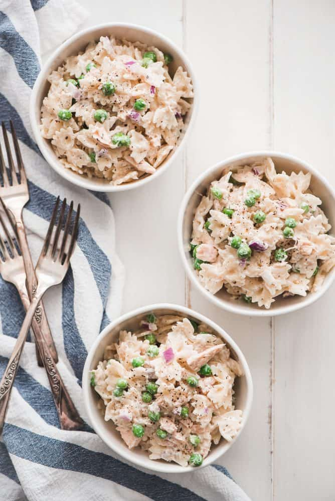 Tuna Pasta Salad in white bowls and forks.