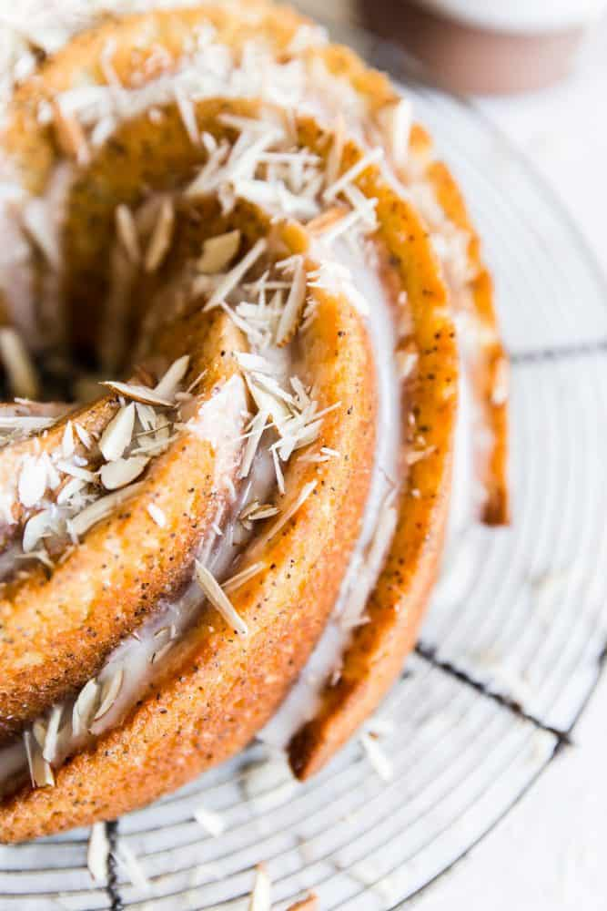 Close up of almond poppyseed bundt cake on a cooling rack.