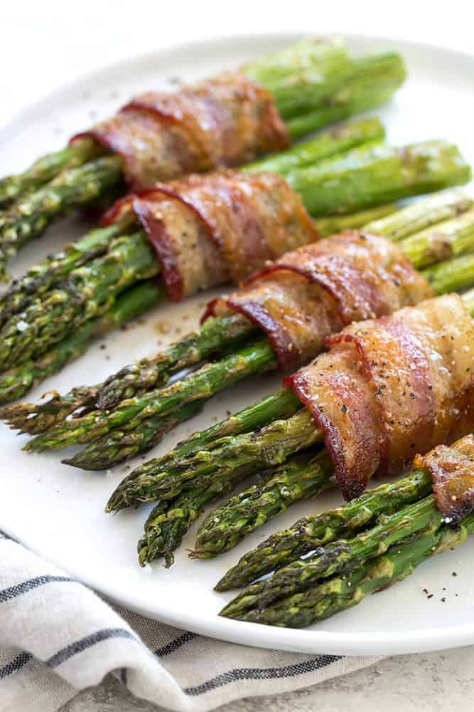 A plate of bacon wrapped asparagus.
