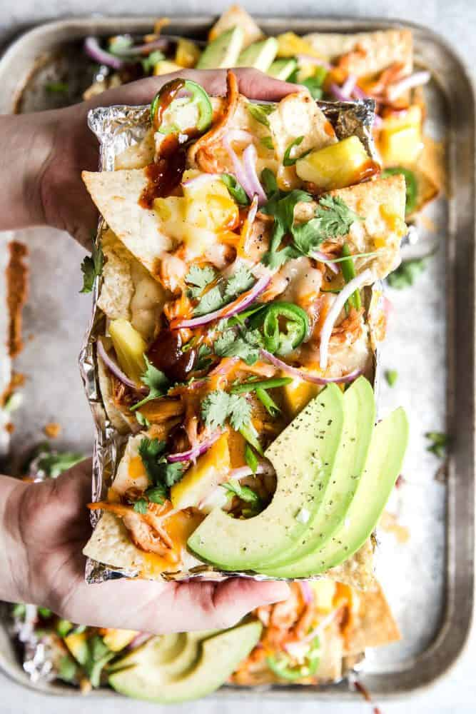 Close up of BBQ Chicken Nachos with fresh avocado on top.