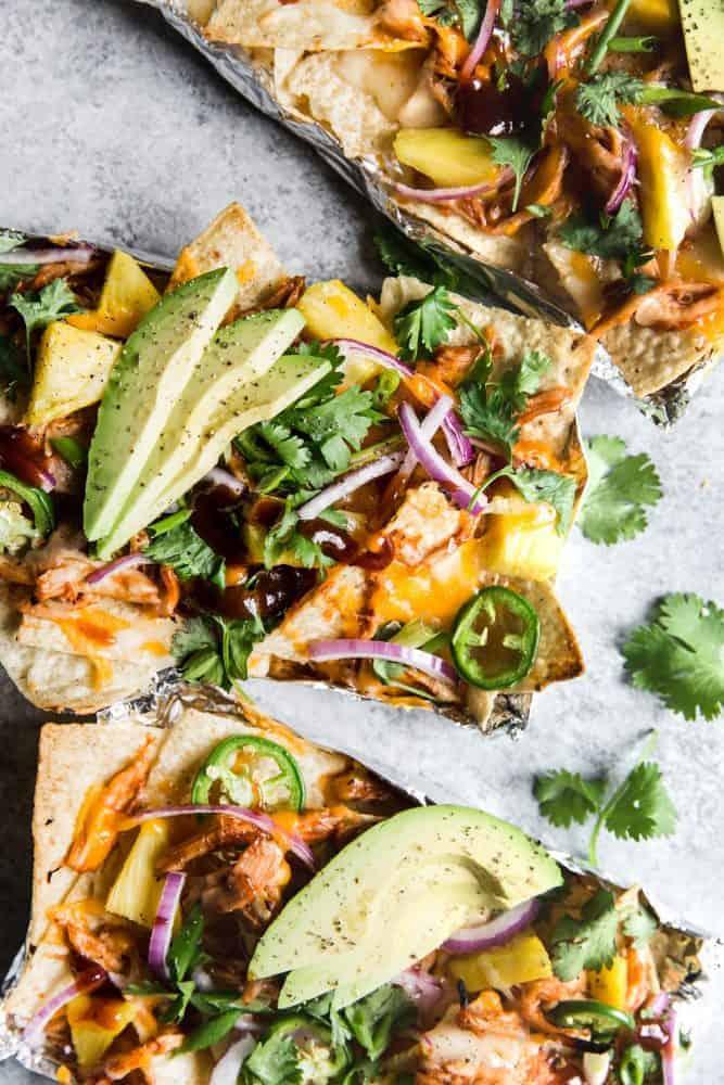 BBQ Chicken Nachos with fresh avocado on top.