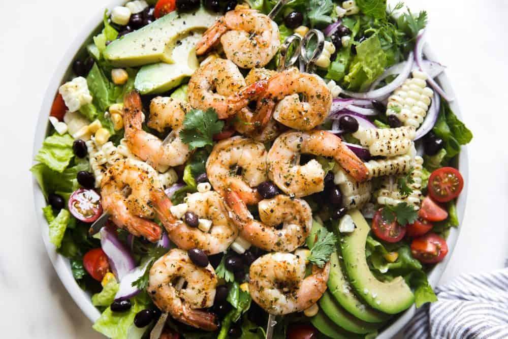 Grilled Shrimp Salad in a white bowl.