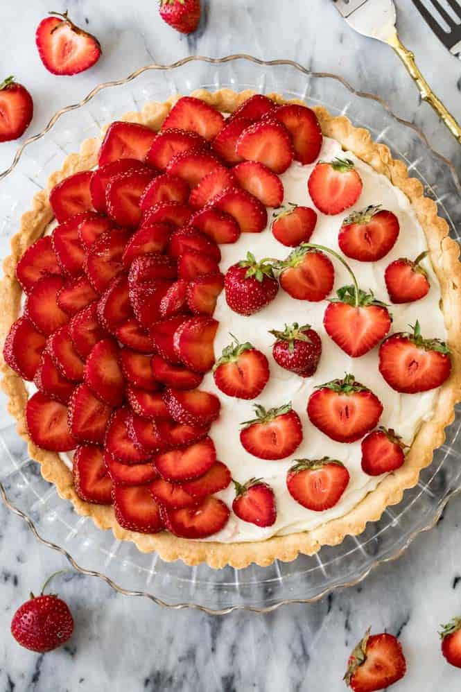 Strawberry Tart in a clear pie pan.