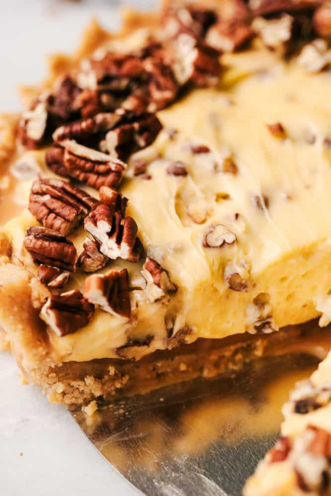 No Bake Banana Caramel Pecan Pie with a slice removed.