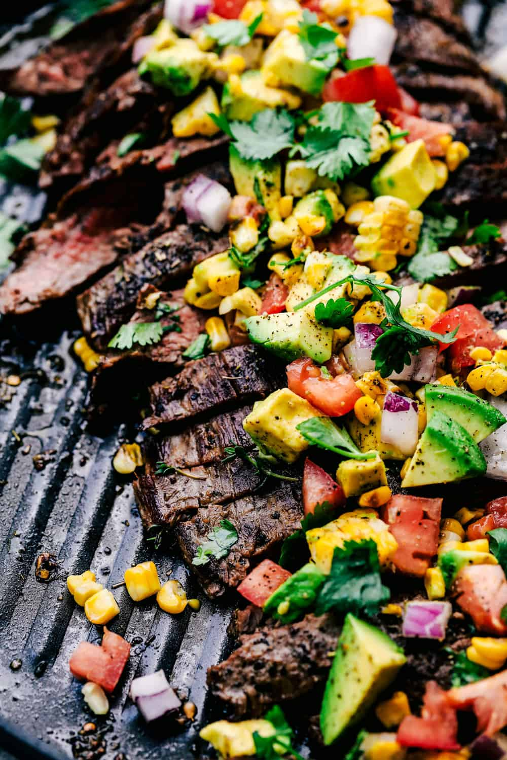 Grilled flank steak on a skillet.