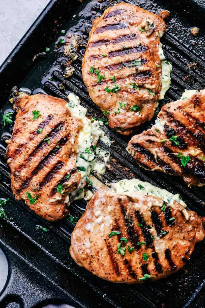 Cooked Herb Stuffed Pork Chops on a grill pan.
