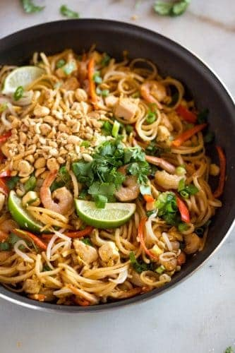 Homemade pad thai, in a skillet, ready to serve.