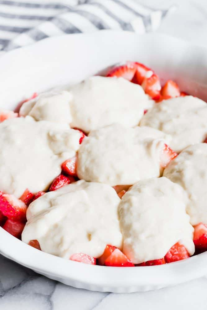 Strawberry Cobbler in a white dish.